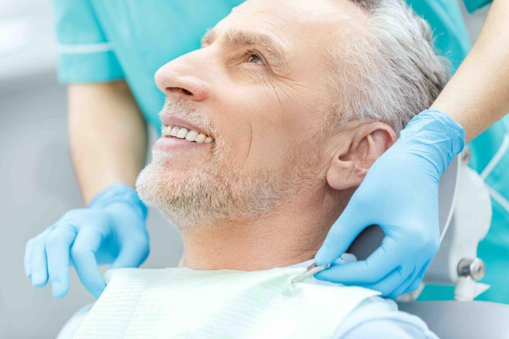 Smiling old man preparing for endodontic treatment